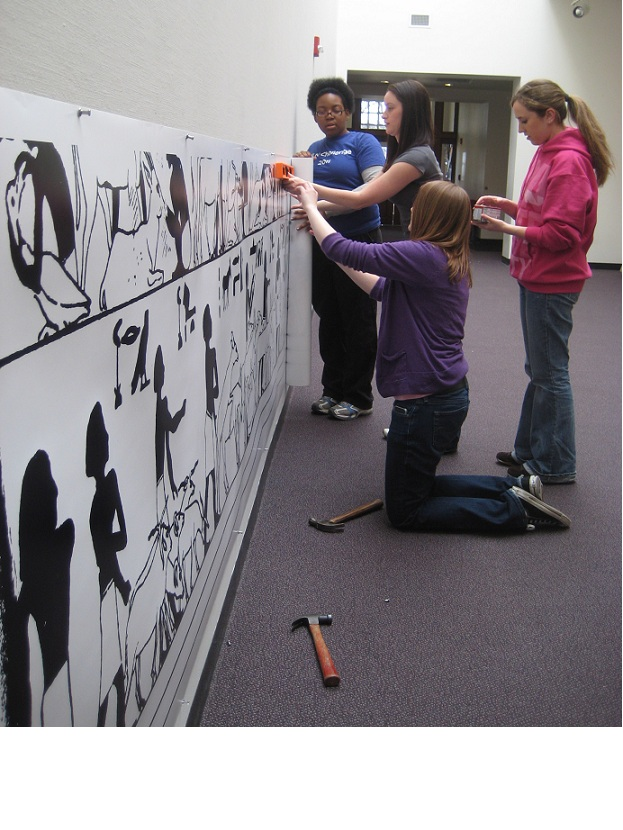 Students setting up lowest frieze
